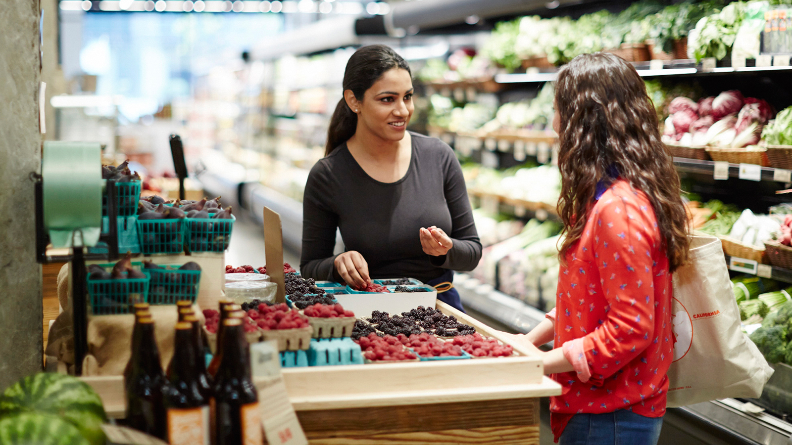 Women shopping in a retail grocery store.