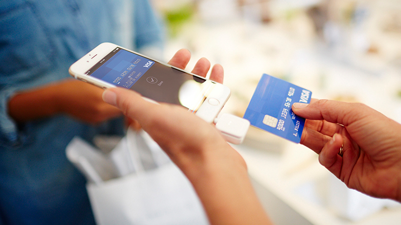 Merchant accepting Visa mobile payment transaction