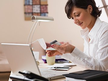 woman-computer-registering-card-online