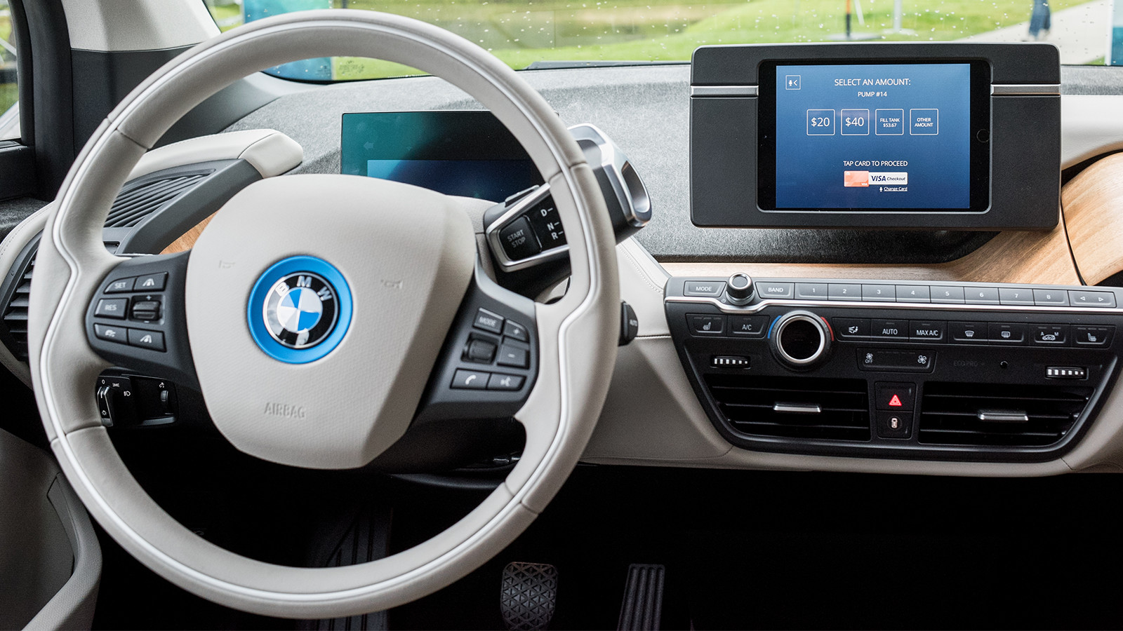 Interior of car with a payment terminal